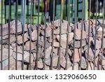 gabion from vertical metal rods ... | Shutterstock . vector #1329060650