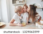 kissing lovely child from two... | Shutterstock . vector #1329063599
