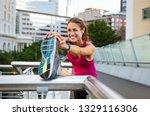 smiling mature woman doing...   Shutterstock . vector #1329116306