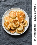 heap of mini pancakes on a gray ... | Shutterstock . vector #1329139853