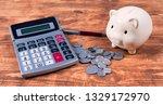 piggy bank  calculator and coins | Shutterstock . vector #1329172970