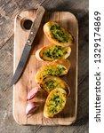 garlic bread on wooden table....   Shutterstock . vector #1329174869