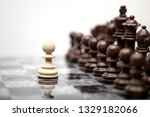 Small photo of One pawn staying against full set of chess pieces. Creative success business concept meaningful photo of one pawn staying against full set of chess figures pieces on board.