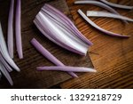 red onion cut into strips on an ...