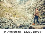 Caucasian Hiker in His 30s Enjoying Raw Alpine Landscape. Active Outdoor Lifestyle. - stock photo