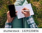 a student writes in a notebook... | Shutterstock . vector #1329220856