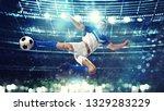 soccer striker hits the ball... | Shutterstock . vector #1329283229