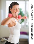 woman exercising with dumbbells ... | Shutterstock . vector #132929780