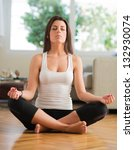 young woman practicing yoga in... | Shutterstock . vector #132930074