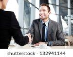 happy businessman shaking hand... | Shutterstock . vector #132941144