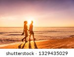 Couple Walking On Beach At...