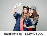 two swag sisters taking self... | Shutterstock . vector #1329476000