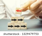 a man holds a wooden block with ... | Shutterstock . vector #1329479753