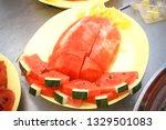slices of fresh watermelon on... | Shutterstock . vector #1329501083