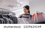woman shopping for clothes... | Shutterstock . vector #1329624149