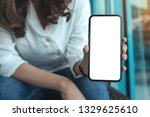 mockup image of a woman holding ... | Shutterstock . vector #1329625610