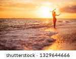 carefree woman dancing in the... | Shutterstock . vector #1329644666