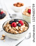 oatmeal porridge with berries ... | Shutterstock . vector #1329683759