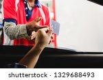 man in a car using a debit card ...   Shutterstock . vector #1329688493