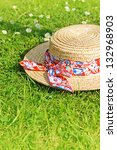 Summer Straw Hat On The Grass...