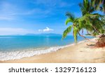 beach and coconut plm tree | Shutterstock . vector #1329716123