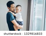 asian father hold little son... | Shutterstock . vector #1329816833