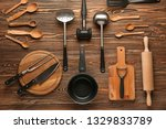 set of kitchenware on wooden... | Shutterstock . vector #1329833789