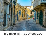 view of a narrow street in... | Shutterstock . vector #1329883280