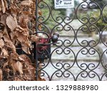Old Garden Gate With Sign ...