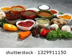 spices and herbs on table. food ... | Shutterstock . vector #1329911150
