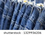 many denim jeans hanging on a... | Shutterstock . vector #1329936206