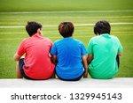 kids sitting on green sport... | Shutterstock . vector #1329945143
