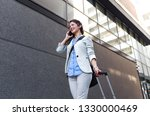 young woman on business trip... | Shutterstock . vector #1330000469