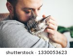 Stock photo cat and man portrait of happy cat with close eyes and young beard man handsome young man is 1330053623