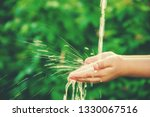 water flows into the hands of... | Shutterstock . vector #1330067516