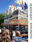 Small photo of ST PAUL, MINNESOTA / USA - JUNE 05, 2016: Garish food stand selling lemonade, French Fries and cheese curds at the Grand Old Day street fair.