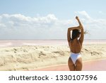 sexy woman in white swimsuit... | Shutterstock . vector #1330107596