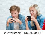 happy young couple is drinking... | Shutterstock . vector #1330163513