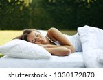 teenage girl sleeping on soft... | Shutterstock . vector #1330172870