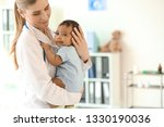 pediatrician with african... | Shutterstock . vector #1330190036