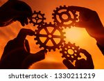 gears in the hands of four... | Shutterstock . vector #1330211219