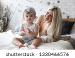 young mother holding her... | Shutterstock . vector #1330466576