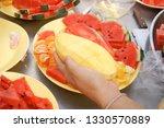 women are cutting ripe mangoes | Shutterstock . vector #1330570889