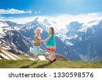 children hiking in alps...   Shutterstock . vector #1330598576