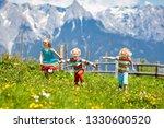 children hiking in alps...   Shutterstock . vector #1330600520