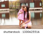 mother and daughter are... | Shutterstock . vector #1330625516
