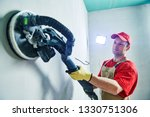 worker smoothig and finishing... | Shutterstock . vector #1330751306
