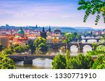 Scenic view on bridges over Vltava river in Prague city. Charles bridge (Karluv Most) and old historical buildings, Czech Republic. - stock photo