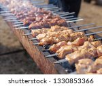 shish kebab on skewers is fried ... | Shutterstock . vector #1330853366