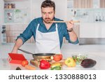 young man is cooking in his... | Shutterstock . vector #1330888013
